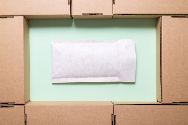 Lot of brown cardboard boxes with envelope Premium Photo