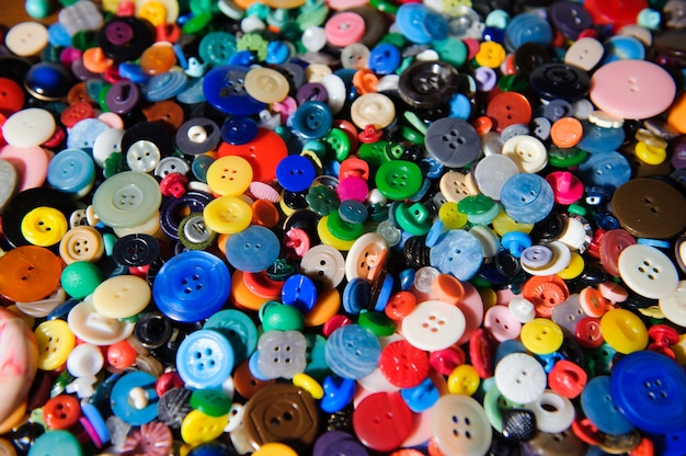 Lot of colorful plastic clothing buttons. many small round vinta Premium Photo