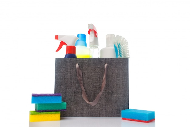 A lot of different cleaning supplies and household cleaning products in a paper bag Premium Photo