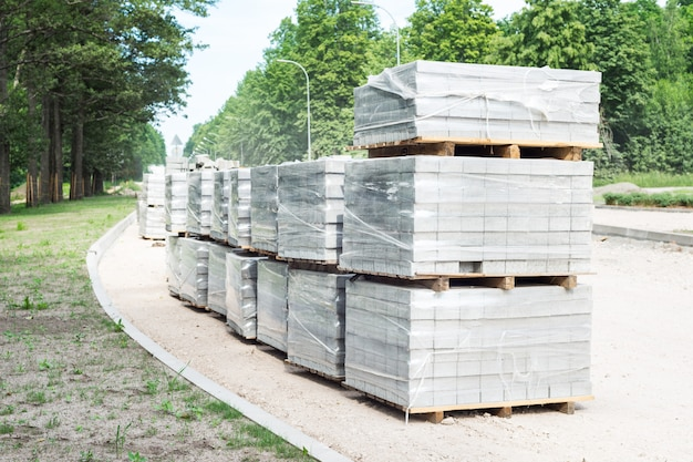 Lot of pallets with bloks for road street works