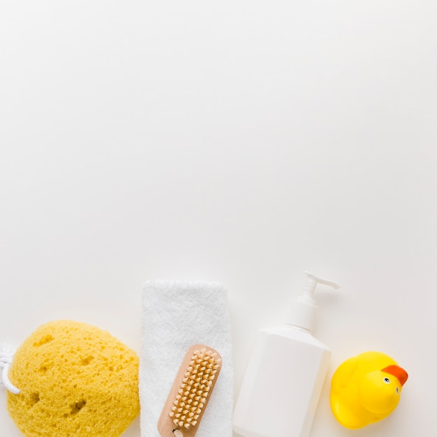 Lotion bottle and sponge copy space Free Photo