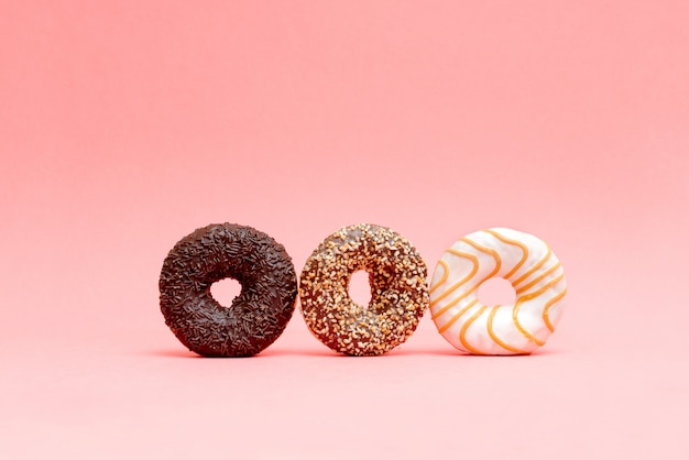 Lots of beautiful donuts on blue background Premium Photo