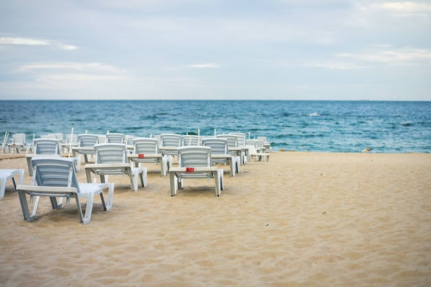 Lots of empty chairs on a deserted beach Premium Photo