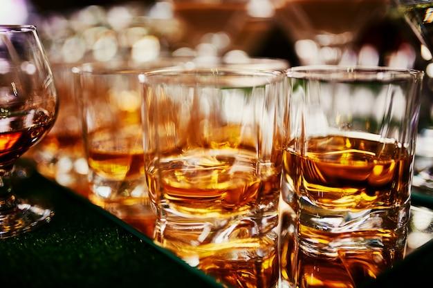 Lots of glasses of whiskey Premium Photo