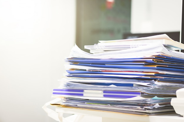 A lots of unfinished documents on office desk. pile of documents paper. Premium Photo