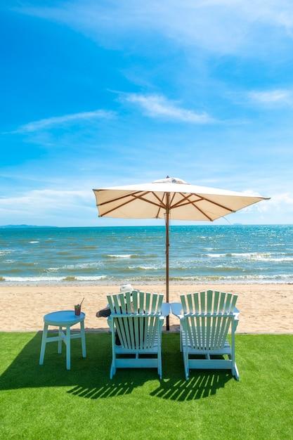 Lounge chairs with sun umbrella on a beach Premium Photo