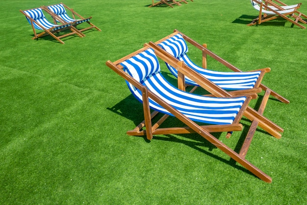 Lounge chairs with sun umbrella on a beach Premium Photo