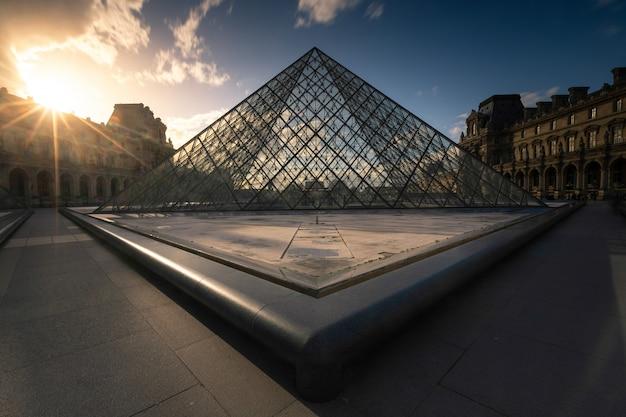 Louvre museum pyramid at the city center of paris Premium Photo