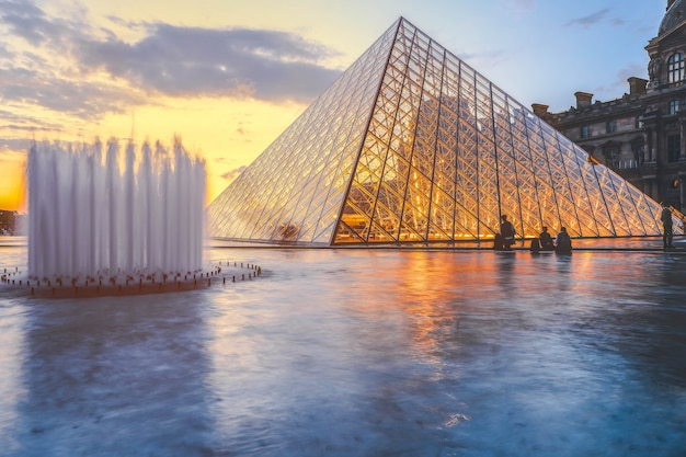 Louvre museum at twilight in winter, this is one of the most popular landmark in paris Premium Photo