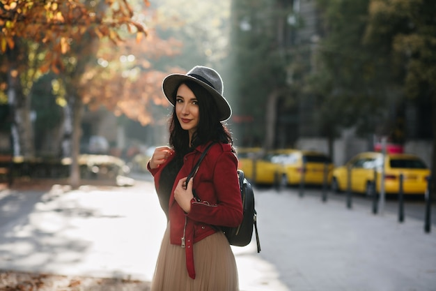 lovable brunette woman with backpack spending time outdoor sunny day 197531 6340