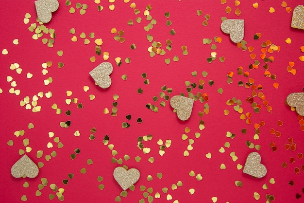 Love abstract red background with golden glitter. party or valentine's day flat lay. Premium Photo