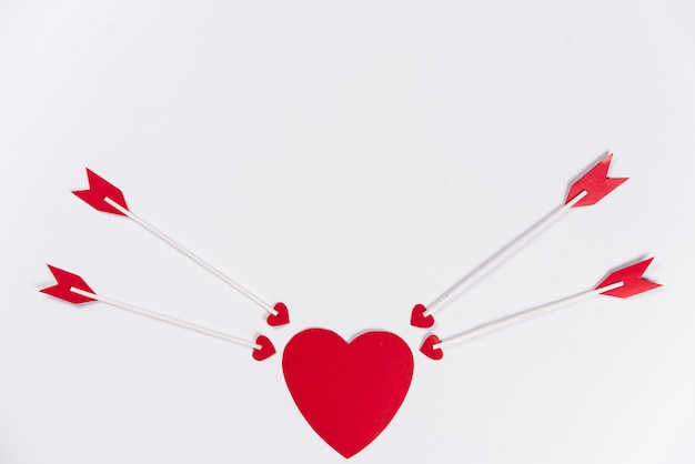Love arrows aiming at red heart Free Photo