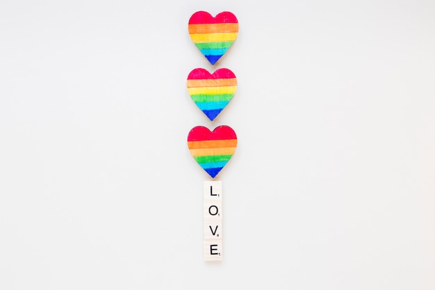 Love inscription with rainbow hearts Free Photo