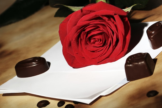 Love letter and red rose Free Photo