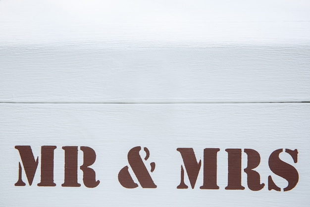 Love and relationship. inscription mr and mrs on white wooden Premium Photo