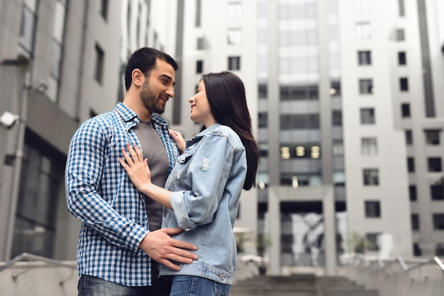 Love story in dull rainy day boy and girl hugging. Premium Photo