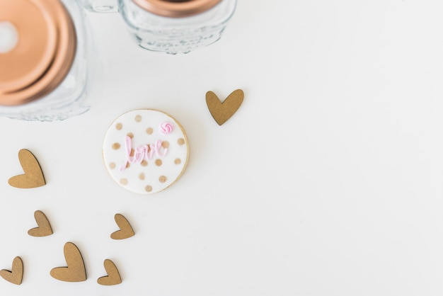 Love text on homemade cookie with heart shape isolated on white backdrop Free Photo