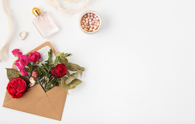 Love or valentine's day concept. red beautiful roses in envelopen Free Photo
