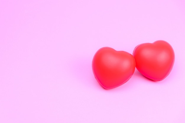 Love for valentine's day with two red heart instead of the couples. Premium Photo