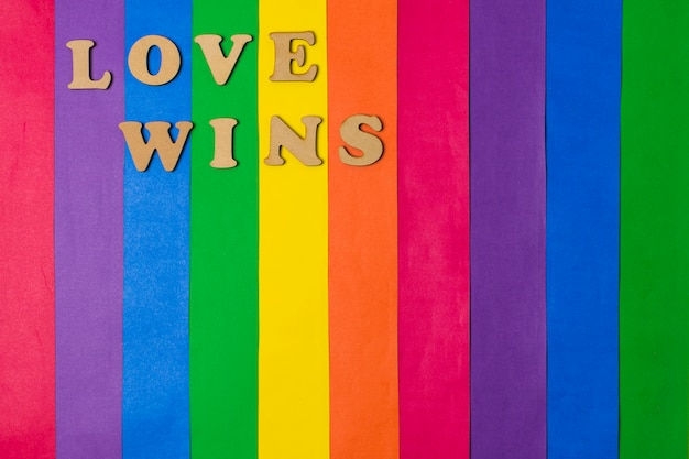 Love wins words and bright gay flag Free Photo