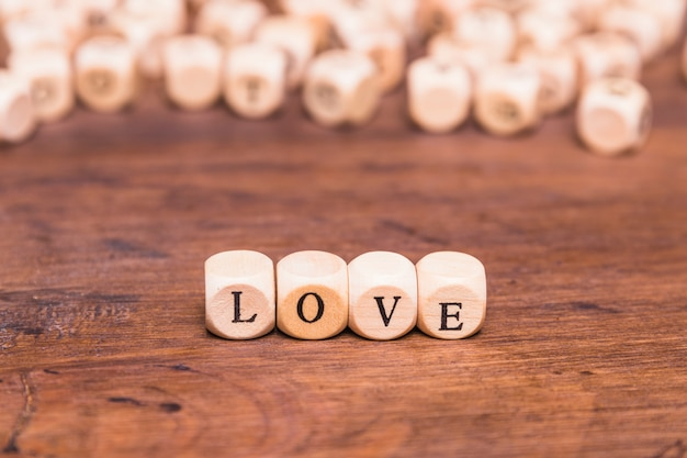 Love word arranged on wooden table Free Photo