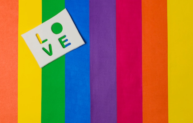 Love word on tablet and bright lgbt flag Free Photo