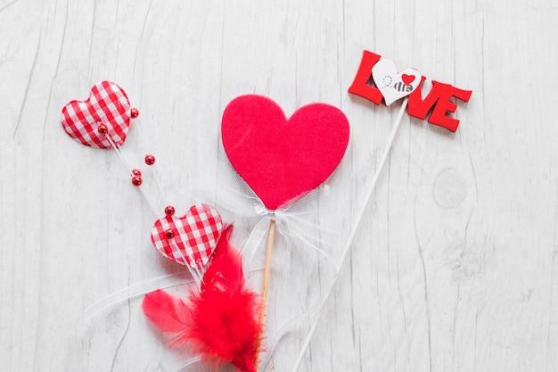 Любовь письма и сердца на палочках Бесплатные Фотографии