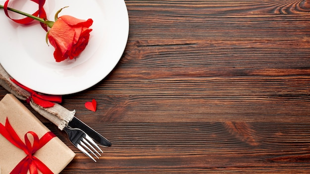 Lovely arrangement for valentines day dinner on wooden background with copy space Free Photo