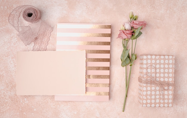 Lovely arrangement with wedding invitations and flowers Free Photo