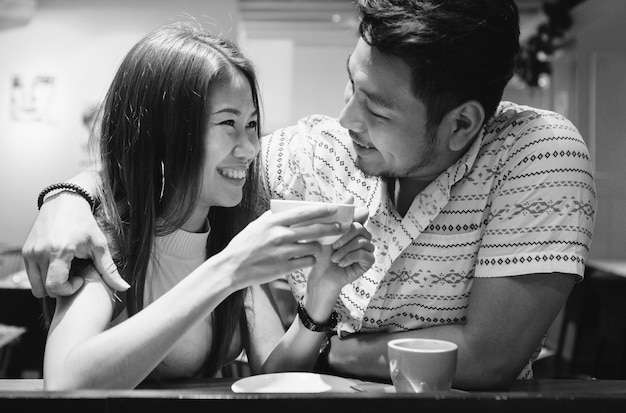Lovely asian couple having coffee 53876 30706