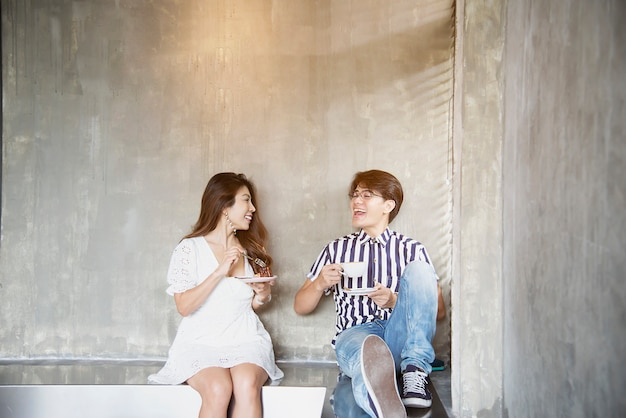 Lovely asian couple portrait in coffee shop, happy people lifestyle Free Photo