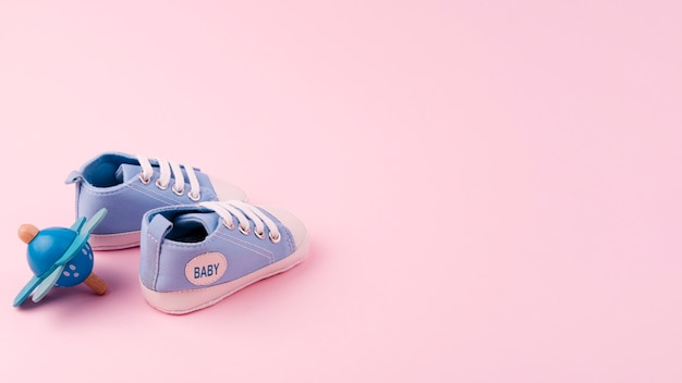Lovely baby shoes with copy space Free Photo