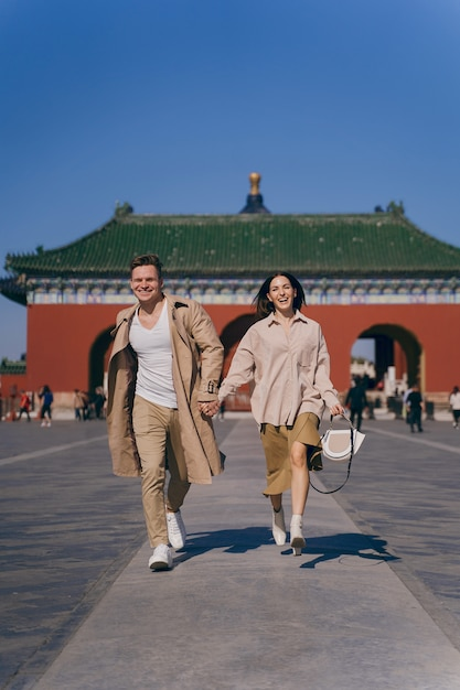 Lovely couple exploring tourist attractions in beijing china Free Photo