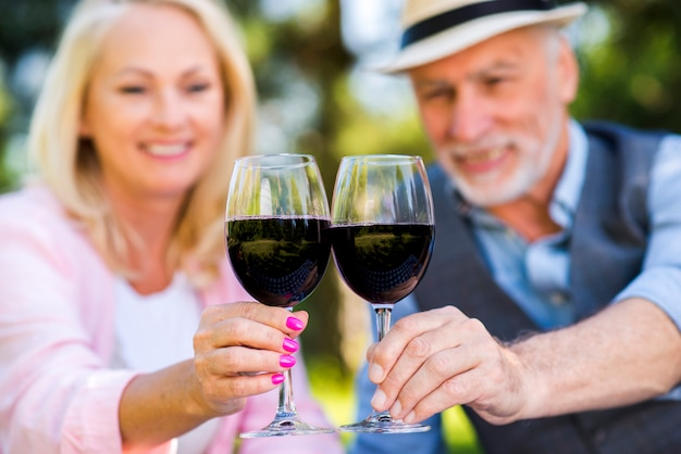 Lovely couple holding two glasses of wine Free Photo