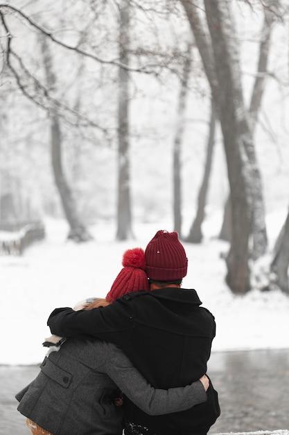 Lovely couple hugging outdoors medium shot Free Photo
