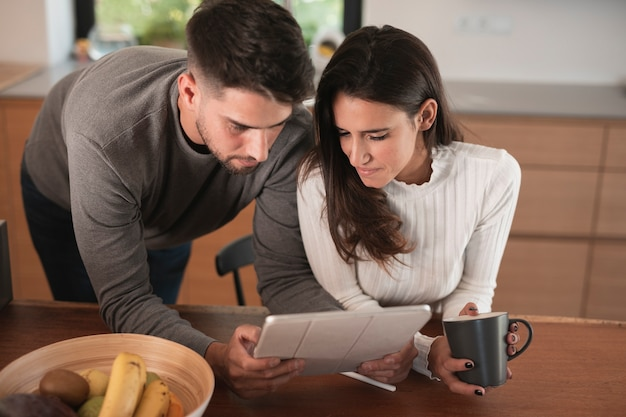 Lovely couple looking at tablet Free Photo