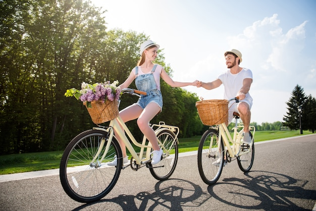 Lovely couple posing together outdoors with bicycles Premium Photo