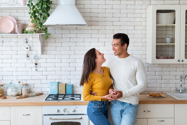 Lovely couple together in kitchen Free Photo