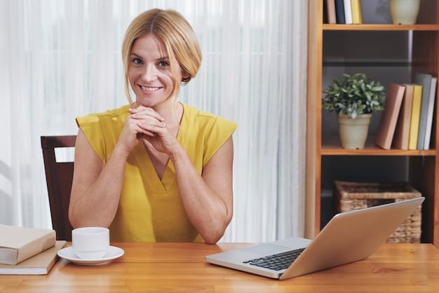 Lovely entrepreneur at office desk Free Photo