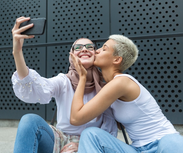 Lovely friends taking a selfie together Free Photo