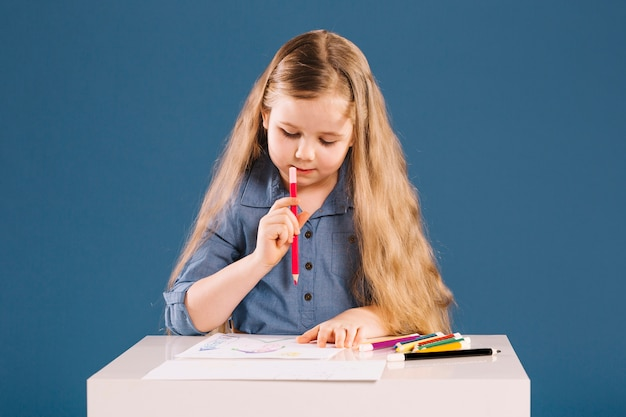 Lovely girl drawing at table Free Photo