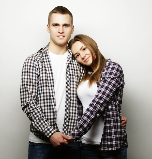 Lovely happy couple hugging over grey background. Premium Photo