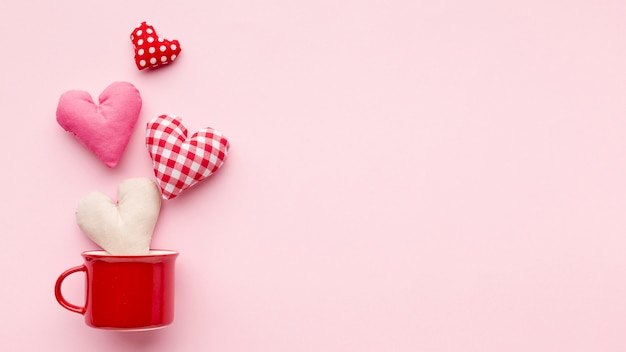 Lovely hearts on pink background with copy space Free Photo