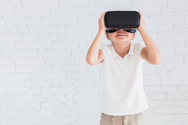 Lovely little girl having fun with virtual reality glasses Free Photo