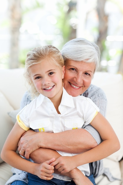 Lovely little girl with her grandmother looking at the camera Premium Photo
