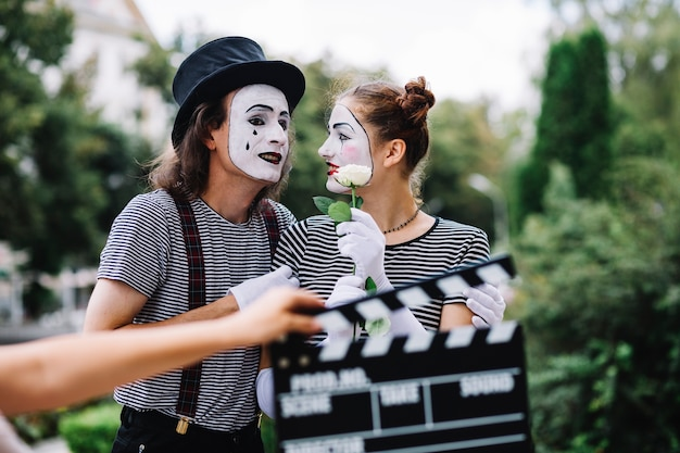 Lovely mime couple with flower standing in park Free Photo