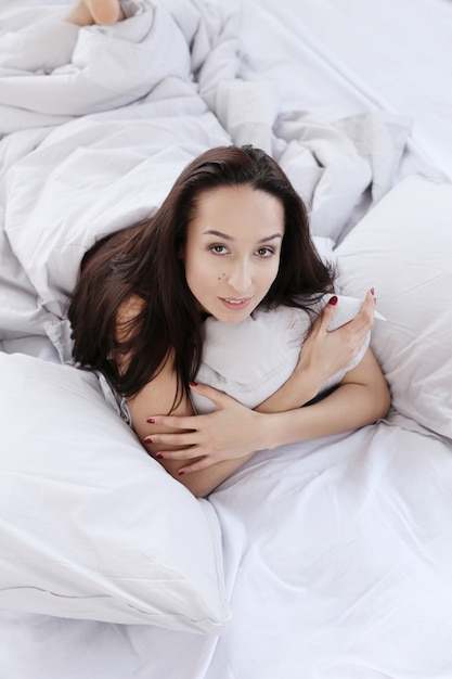 Lovely woman on bed Free Photo