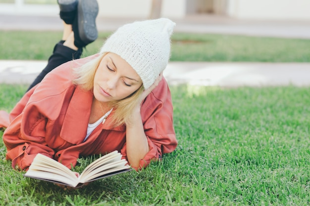 Lovely woman reading book on grass Free Photo