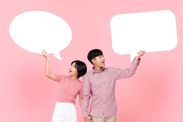 Lovely young asian couple with speech bubbles Premium Photo