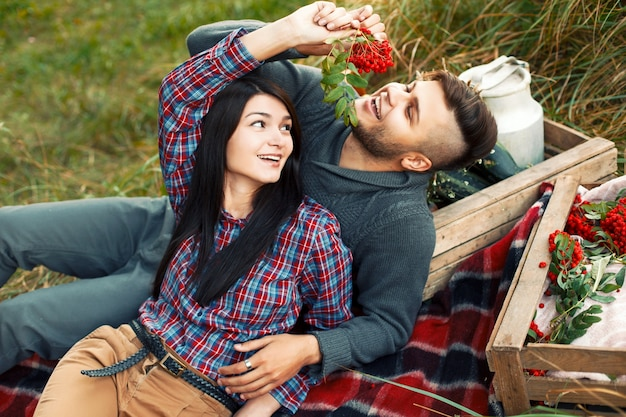 Lovely young couple having fun on the grass Free Photo